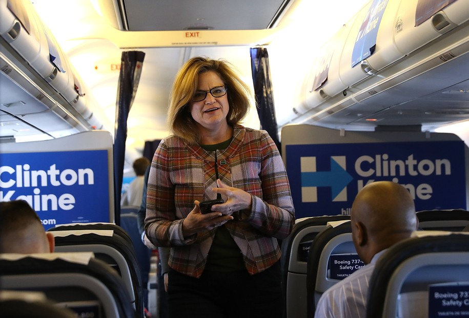IN FLIGHT, UNITED STATES - OCTOBER 28:  Jennifer Palmieri, communications director for Democratic presidential nominee former Secretary of State Hillary Clinton aboard the campaign plane while traveling to Cedar Rapids, Iowa  October 28, 2016. With less than two weeks to go until election day, Hillary Clinton is campaigning in Iowa.  (Photo by Justin Sullivan/Getty Images)