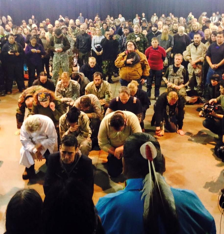 Veterans kneel before tribal members and ask forgiveness