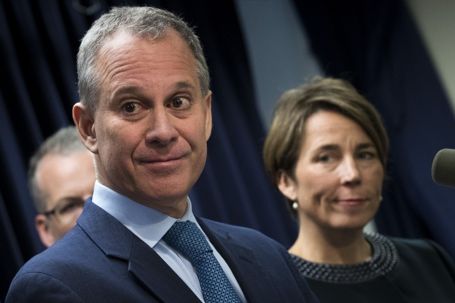 NEW YORK, NY - JULY 19: ( L to R) New York Attorney General Eric Schneiderman and Massachusetts Attorney General Maura Healey listen to a question from a reporter during a press conference at the office of the New York Attorney General, July 19, 2016 in New York City. They announced lawsuits against Volkswagen AG and its affiliates Audi AG and Porsche AG for their sale of diesel vehicles that were outfitted with illegal 'defeat devices' that concealed illegal amounts of emissions and the subsequent cover-up. (Photo by Drew Angerer/Getty Images)