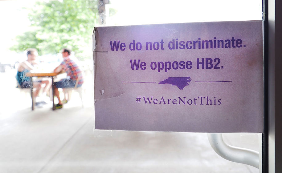 "DURHAM, NC - MAY 10:  The ""We Are Not This"" slogan is posted at the entrances to Bull McCabes Irish Pub on May 10, 2016 in Durham, North Carolina.  Debate over transgender bathroom access spreads nationwide as the U.S. Department of Justice countersues North Carolina Governor Pat McCrory from enforcing the provisions of House Bill 2 (HB2) that dictate what bathrooms transgender individuals can use.  (Photo by Sara D. Davis/Getty Images)"