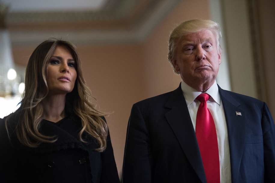 US President-elect Donald Trump and his wife Melania take a question from the press after a meeting with Senate Majority Leader Mitch McConnell at the Capitol in Washington, DC, on November 10, 2016 / AFP / NICHOLAS KAMM        (Photo credit should read NICHOLAS KAMM/AFP/Getty Images)