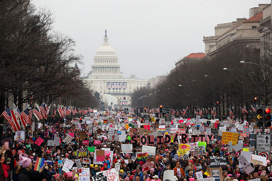 WASHINGTON, DC - JANUARY 21:  Protesters march down Pennsylvania avenue during the Women's March on Washington January 21, 2017 in Washington, DC. The march is expected to draw thousands from across the country to protest newly inaugurated President Donald Trump. (Photo by Aaron P. Bernstein/Getty Images)
