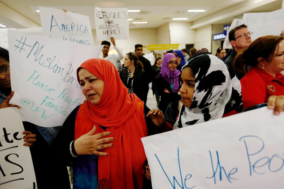 A woman, left, who did not want to be identified reacts after hearing news that her mother may not be released from immigration at DFW airport, Saturday, Jan. 28, 2017. President Donald Trump signed an executive order barring muslims from certain countries from entering the Untied States. (Brandon Wade/Star-Telegram via AP)