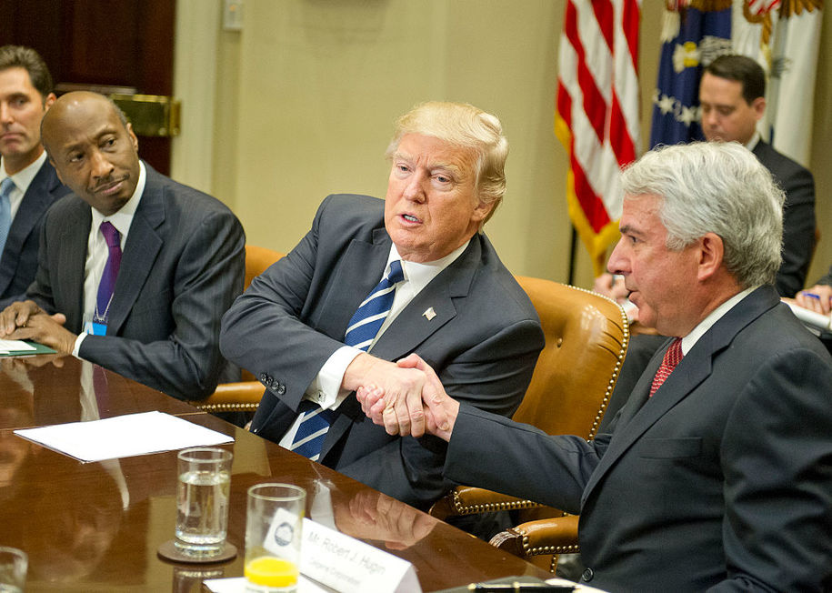 "WASHINGTON, DC - JANUARY 31: (AFP OUT) U.S. President Donald Trump shakes hands with Robert J. Hugin, Executive Chairman, Celgene Corporation, as he meets with representatives from PhRMA, the Pharmaceutical Research and Manufacturers of America in the Roosevelt Room of the White House on January 31, 2017 in Washington, DC.  According to its website, PhRMA ""represents the country's leading biopharmaceutical researchers and biotechnology companies."" Kenneth C. Frazier, Chairman and CEO of Merck & Co. looks on from left. (Photo by Ron Sachs - Pool/Getty Images)"