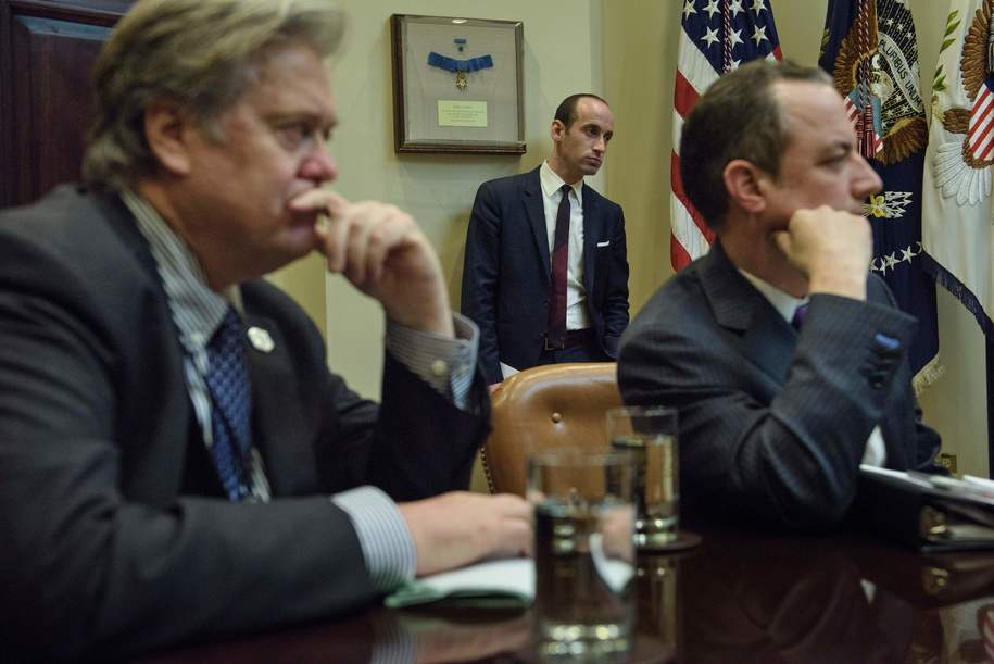 From left: Trump advisor Steve Bannon, advisor Stephen Miller and White House Chief of Staff Reince Priebus listen while US President Donald Trump speaks at the beginning of a meeting with lawmakers in the Roosevelt Room of the White House February 2, 2017 in Washington, DC. / AFP / Brendan Smialowski        (Photo credit should read BRENDAN SMIALOWSKI/AFP/Getty Images)