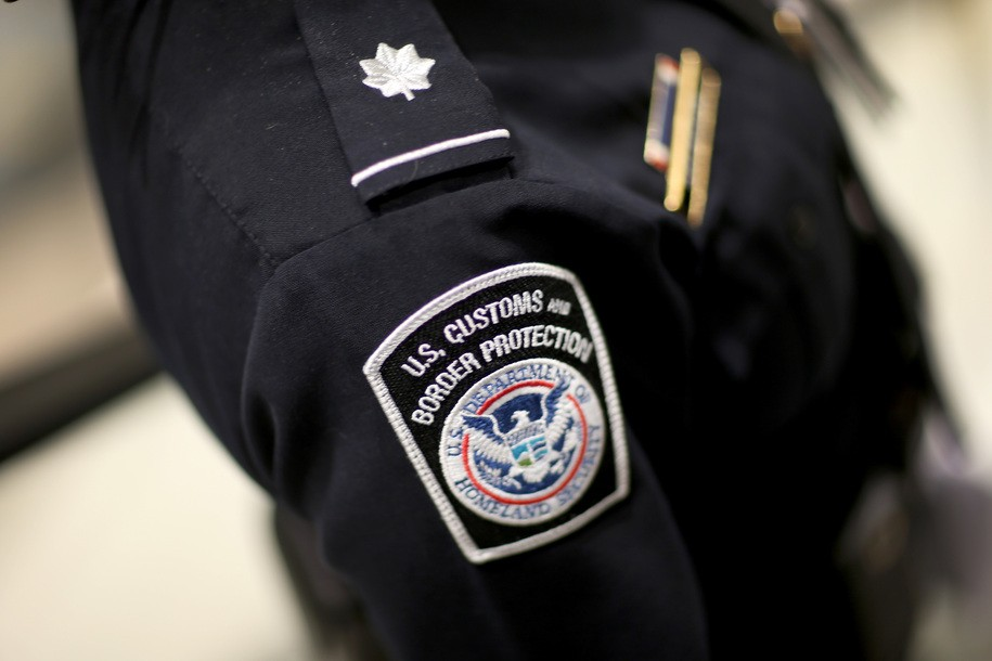 MIAMI, FL - MARCH 04:  A U.S. Customs and Border Protection officer's patch is seen as they unveil a new mobile app for international travelers arriving at Miami International Airport on March 4, 2015 in Miami, Florida. Miami-Dade Aviation Department and U.S. Customs and Border Protection (CBP) unveiled a new mobile app for expedited passport and customs screening. The app for iOS and Android devices allows U.S. citizens and some Canadian citizens to enter and submit their passport and customs declaration information using their smartphone or tablet and to help avoid the long waits in the exit lanes.  (Photo by Joe Raedle/Getty Images)