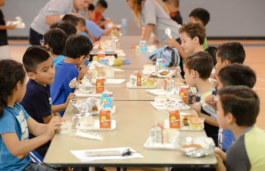 Children enjoy lunches provided by the Brownsville Independent School District on Wednesday, June 8, 2016, at the Olivera Park gymnasium in Brownsville, Texas. The local school district provides free lunches to any child under 18 who needs a meal, regardless of their status as a student with the school district. (Jason Hoekema/The Brownsville Herald via AP) MANDATORY CREDIT