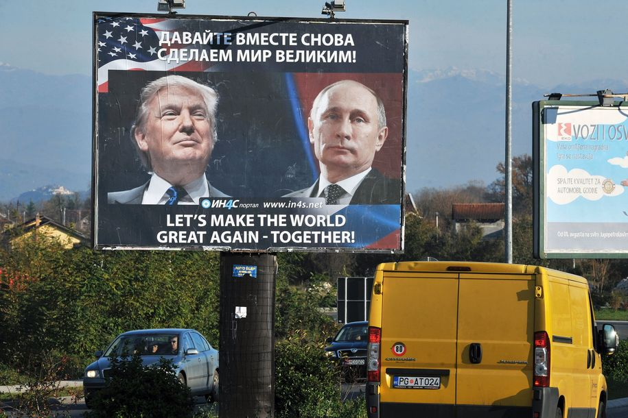 Cars pass by a billboard showing US President-elect Donald Trump and Russian President Vladimir Putin placed by pro-Serbian movement in the town of Danilovgrad on November 16, 2016. . Russian President Vladimir Putin and Donald Trump spoke on the phone on November 15, evening and agreed on the need to normalise ties between Washington and Moscow, the Kremlin said.       / AFP / Savo PRELEVIC        (Photo credit should read SAVO PRELEVIC/AFP/Getty Images)
