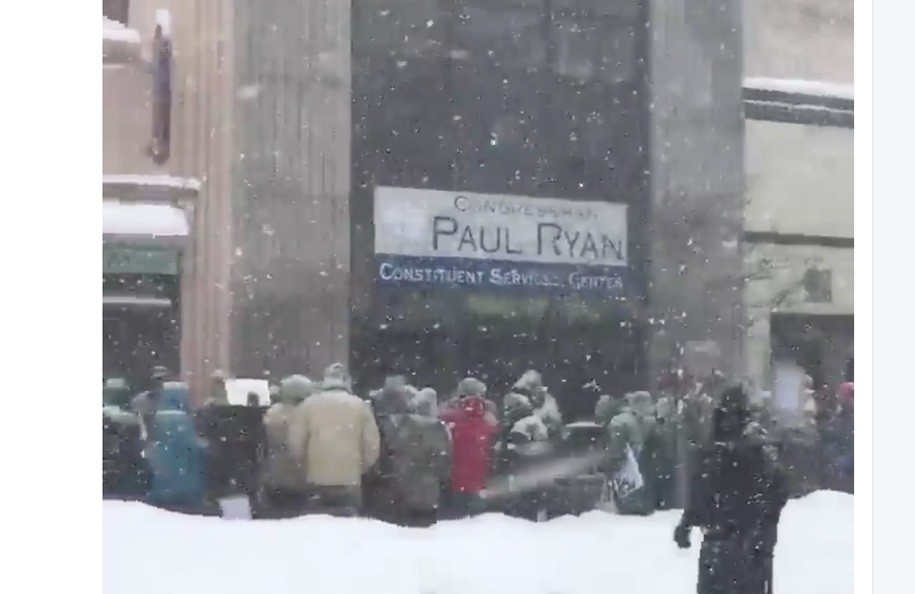 Hundreds march to Paul Ryan's office in freezing temps and  heavy snow