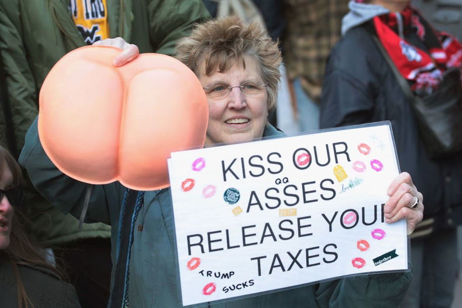 CHICAGO, IL - FEBRUARY 12: Activists gather across from Trump Tower before pulling down their pants and mooning on February 12, 2017 in Chicago, Illinois. The event was staged to protest the policies of President Donald Trump and to demand that he release his tax information. (Photo by Scott Olson/Getty Images)