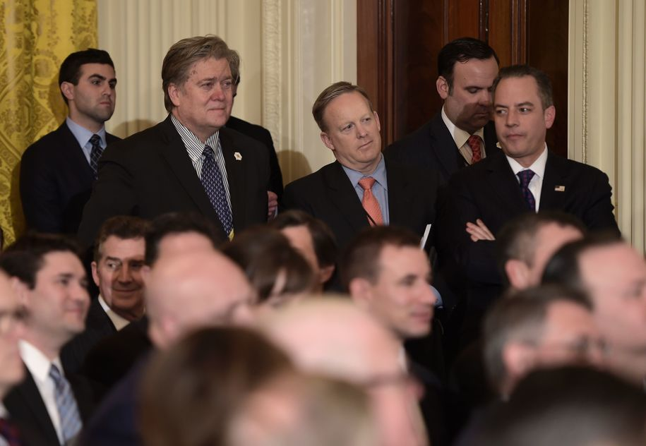 Trump advisor Steve Bannon (2L),  White House Chief of Staff Reince Priebus (R), and White House spokesman Sean Spicer look on before the announcement of the Supreme Court nominee at the White House in Washington, DC, on January 31, 2017..President Donald Trump nominated federal appellate judge Neil Gorsuch as his Supreme Court nominee, tilting the balance of the court back in the conservatives' favor. / AFP / Brendan SMIALOWSKI        (Photo credit should read BRENDAN SMIALOWSKI/AFP/Getty Images)