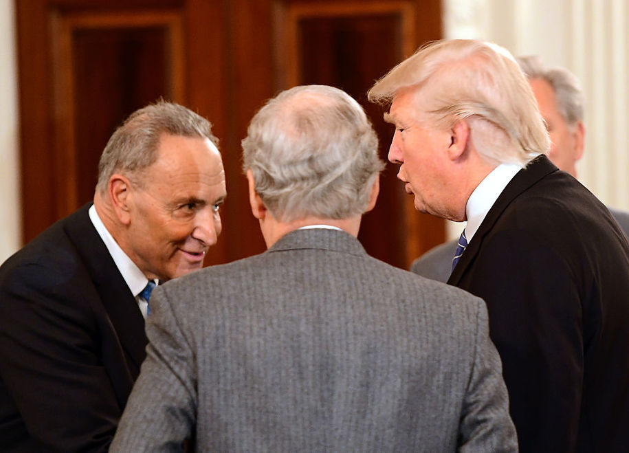WASHINGTON, DC - JANUARY 23:  U.S. President Donald Trump (R) hosts a reception for House and Senate Republican and Democratic leaders in the State Dining Room of the White House January 23, 2017 in Washington, DC.  Attending were Senate Minority Leader Chuck Schumer (D-NY) (L) and Senate Majority Leader Mitch McConnell (R-KY).  (Photo by Ron Sachs-Pool/Getty Images)