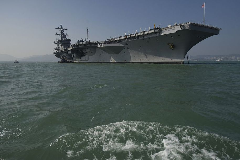 The USS Carl Vinson, a US nuclear powered aircraft carrier, is seen in Hong Kong waters on December 27, 2011.   The USS Carl Vinson, which was commissioned in 1982, is in Hong Kong for a three day visit.  AFP PHOTO / AARON TAM (Photo credit should read aaron tam/AFP/Getty Images)