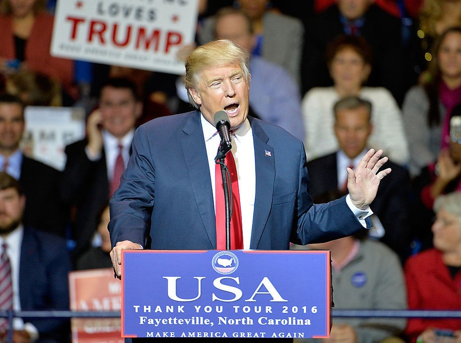 FAYETTEVILLE, NC - DECEMBER 06:  President-elect Donald Trump addresses an audience at Crown Coliseum on December 6, 2016 in Fayetteville, North Carolina. Trump took time off from selecting the cabinet for his incoming administration to celebrate his victory in the general election. (Photo by Sara D. Davis/Getty Images)