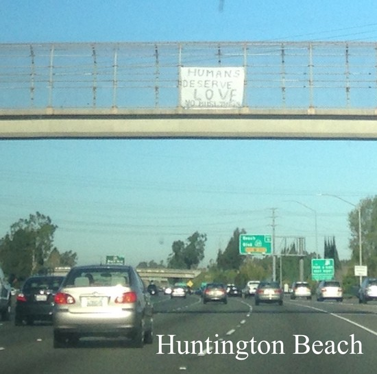 Humans Deserve Love No Muslim Ban sign over I-405 in Huntington Beach.