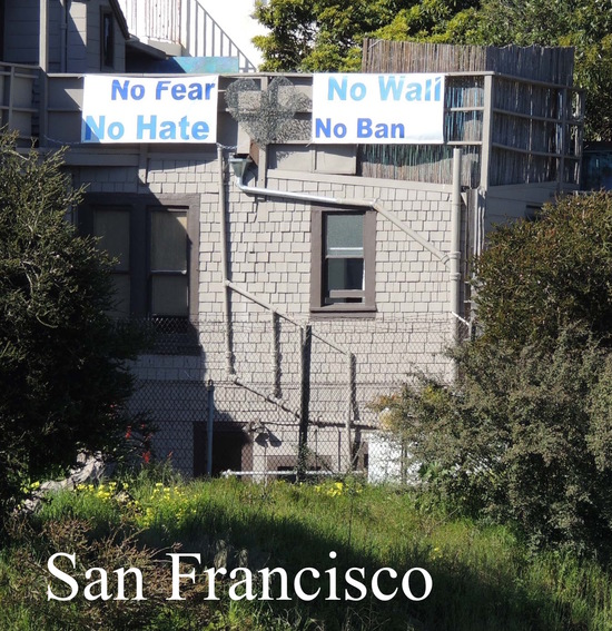 No Fear No Hate No Wall No Ban sign on house next to US 101.