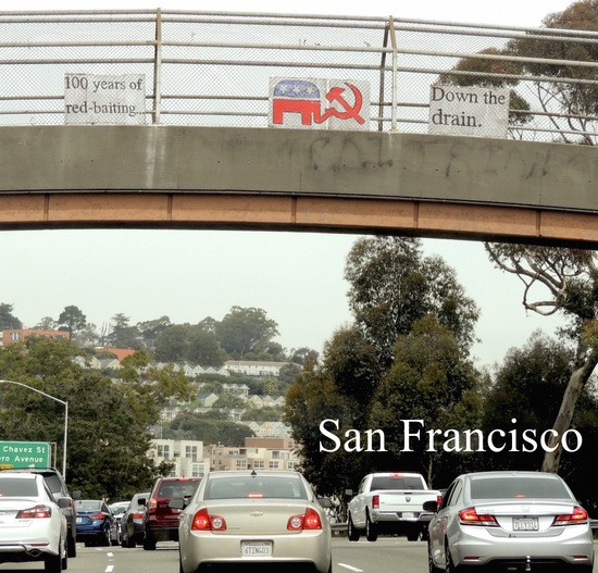 100 Years of red-baiting down the drain sign over US 101.