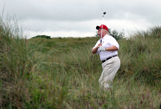 ABERDEEN, SCOTLAND - JULY 10:  Donald Trump plays a round of golf after the opening of The Trump International Golf Links Course on July 10, 2012 in Balmedie, Scotland. The controversial £100m course opens to the public on Sunday July 15. Further plans to
