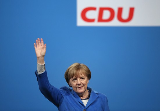 NUERTINGEN, GERMANY - MARCH 08:  German Chancellor and Chairwoman of the German Christian Democrats (CDU) Angela Merkel waves to supporters at the conclusion of a CDU campaign rally ahead of Baden-Wuerttemberg state elections on March 8, 2016 in Nuertingen, Germany. State elections scheduled for March 13 in three German states: Rhineland-Palatinate, Saxony-Anhalt and Baden-Wuerttemberg, will be a crucial test-case for Merkel, who has come under increasing pressure over her liberal immigration policy towards migrants and refugees. The populist Alternative fuer Deutschland (Alternative for Germany, AfD), with campaign rhetoric aimed at Germans who are uneasy with so many newcomers, has solid polling numbers and will almost certainly win seats in all three state parliaments.  (Photo by Sean Gallup/Getty Images)