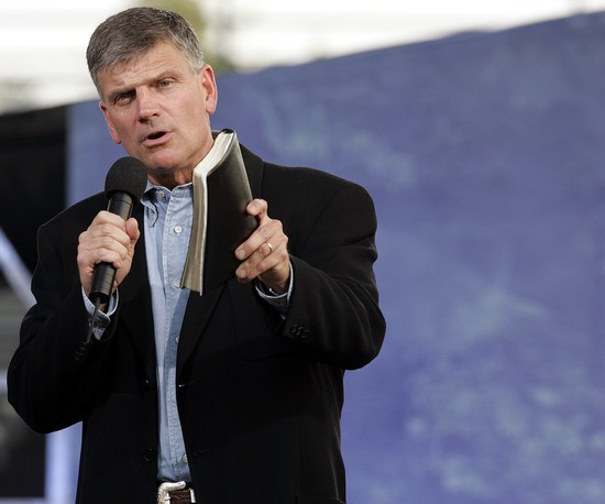 NEW  YORK - JUNE 25:  Franklin Graham, with Bible in hand addresses the crowd before his father Billy Graham speaks during his Crusade at Flushing Meadows Corona Park June 25, 2005 in the Queens borough of New York. Flushing Meadows Corona Park is the site for Graham's sermons on June 24-26, which looks to draw thousands of people from across the country, and will purportedly be the aging Christian evangelist's final crusade. (Photo by Stephen Chernin/Getty Images)
