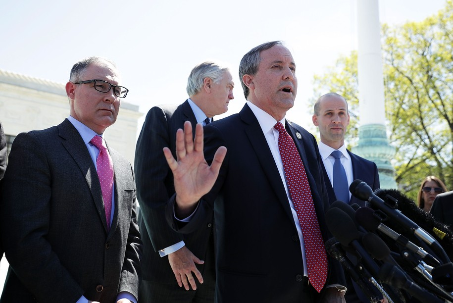 WASHINGTON, UNITED STATES - APRIL 18:  Texas Attorney General Kenneth Paxton speaks to members of the media as Texas Solicitor General Scott Keller (R) listens in front of the U.S. Supreme Court April 18, 2016 in Washington, DC. The Supreme Court heard oral arguments in the case of United States v. Texas, which is challenging President Obama's 2014 executive actions on immigration - the Deferred Action for Children Arrivals (DACA) and Deferred Action for Parents of American and Lawful Permanent Residents (DAPA) programs.  (Photo by Alex Wong/Getty Images)