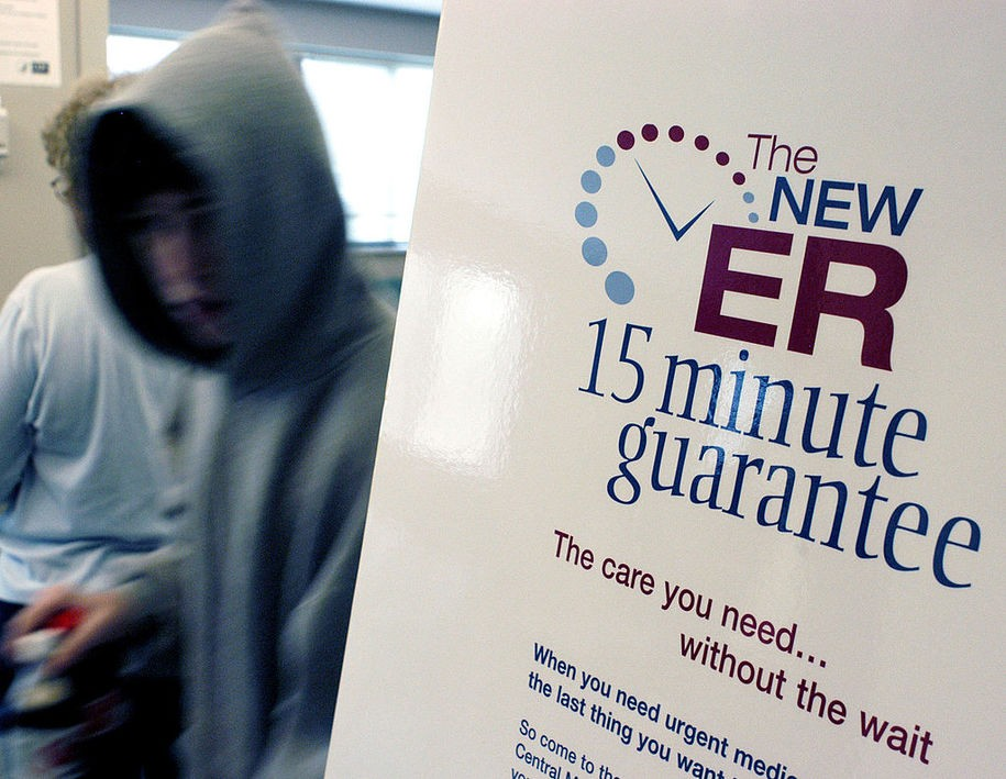 LANSDALE, PA - DECEMBER 10:  David McCreary walks past a sign announcing the 15 minute guarantee in the Emergency Room at Central Montgomery Medical Center December 10, 2004 in Lansdale, Pennsylvania. The medical center is one of a number of hospitals in the U.S. which guarantees emergency room patients will be seen by a nurse in a certain time period or their visit is free. Hospitals in Michigan, Wisconsin, Ohio, New Jersey, and Nevada are offering similar promises to lure the sick and injured away from competitors.  (Photo by William Thomas Cain/Getty Images)