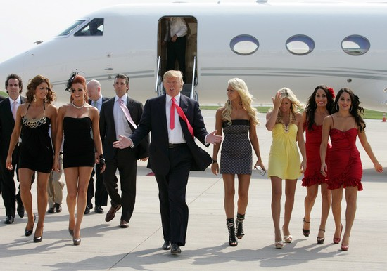 GREEN BAY, WI - JUNE 22:  Donald Trump (C) and the WWE DIVA girls attend a press conference about the WWE at the Austin Straubel International Airport on June 22, 2009 in Green Bay, Wisconsin.  (Photo by Mark A. Wallenfang/Getty Images)