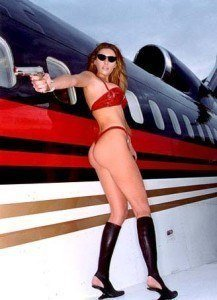 Trump's wife posing with gun...Thong and Boots..And they had a ...
