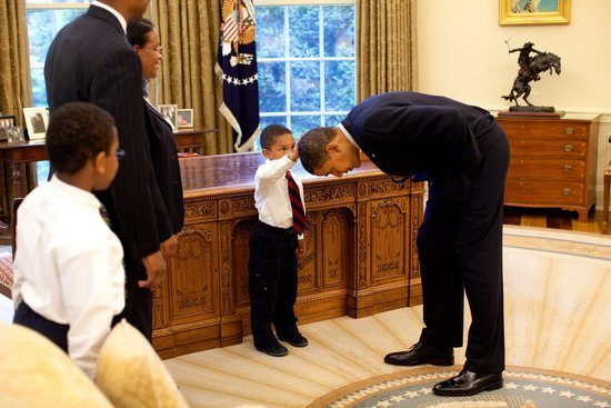 """May 2009 – Jacob Philadelphia asked Obama if his hair was like his, so the most powerful man in the world bowed to a child. The boy had told Obama: """"I want to know if my hair is just like yours."""" The president had replied: """"Touch it, dude!"""""""