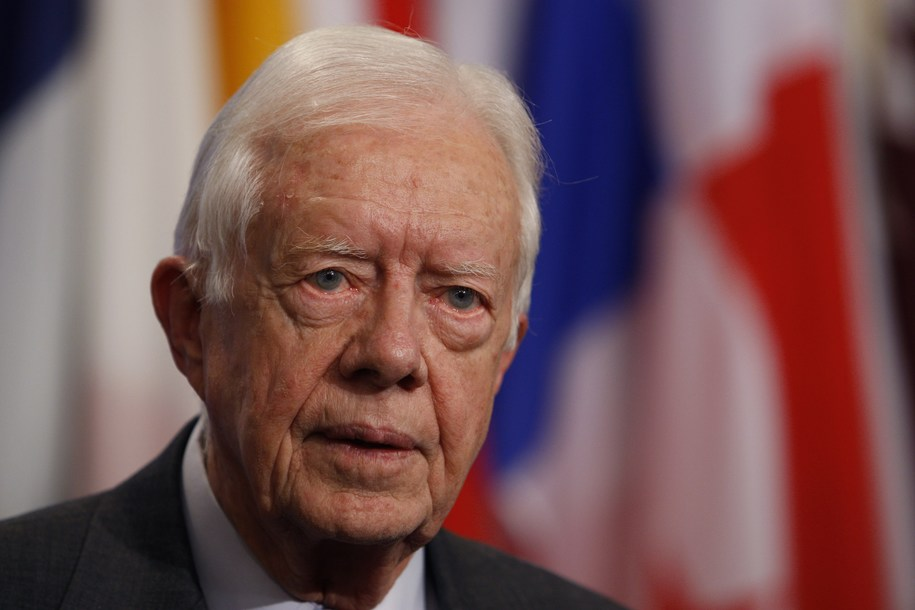 Former US President Jimmy Carter speaks to the media after a meeting with United Nations Secretary General Ban Ki-Moon, 25 October 2007, at UN headquarters in New York.          (Photo credit should read STAN HONDA/AFP/Getty Images)