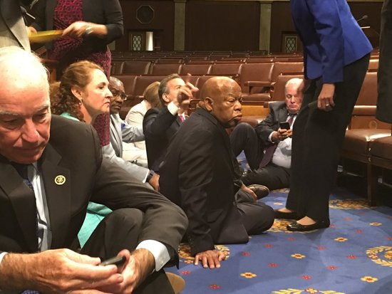 Democrats, led by Rep. John Lewis, sit in at the House for gun legislation.