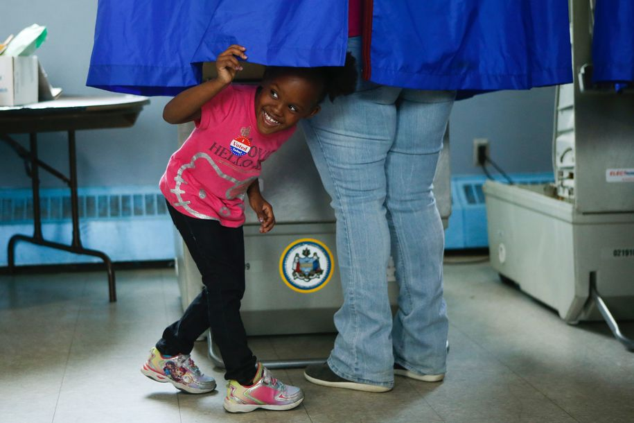 A young girl looks out of a voting booth during Pennsylvania's primary election on April 26, 2016 in Philadelphia, Pennsylvania. .Voters cast ballots in five northeastern states, with frontrunners Hillary Clinton and Donald Trump both looking to overwhelm their respective Democratic and Republican rivals in the race for the White House. / AFP / EDUARDO MUNOZ ALVAREZ        (Photo credit should read EDUARDO MUNOZ ALVAREZ/AFP/Getty Images)