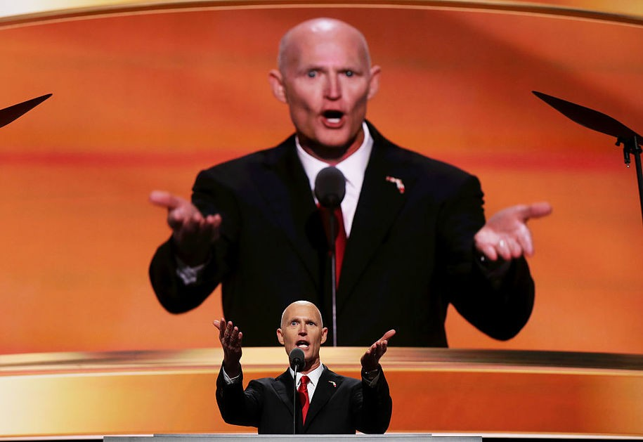 CLEVELAND, OH - JULY 20:  Florida Governor Rick Scott gestures as he delivers a speech on the third day of the Republican National Convention on July 20, 2016 at the Quicken Loans Arena in Cleveland, Ohio. Republican presidential candidate Donald Trump received the number of votes needed to secure the party's nomination. An estimated 50,000 people are expected in Cleveland, including hundreds of protesters and members of the media. The four-day Republican National Convention kicked off on July 18.  (Photo by Chip Somodevilla/Getty Images)