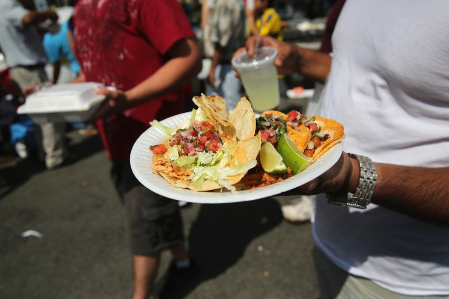 VALHALLA, NY - JULY 20:  A man carries a plate of tacos at the Hispanic Heritage Festival on July 20, 2014 in Valhalla, New York. Thousands of people gathered for the event to celebrate Latino immigrant food, culture and music in Weschester County.  (Photo by John Moore/Getty Images)