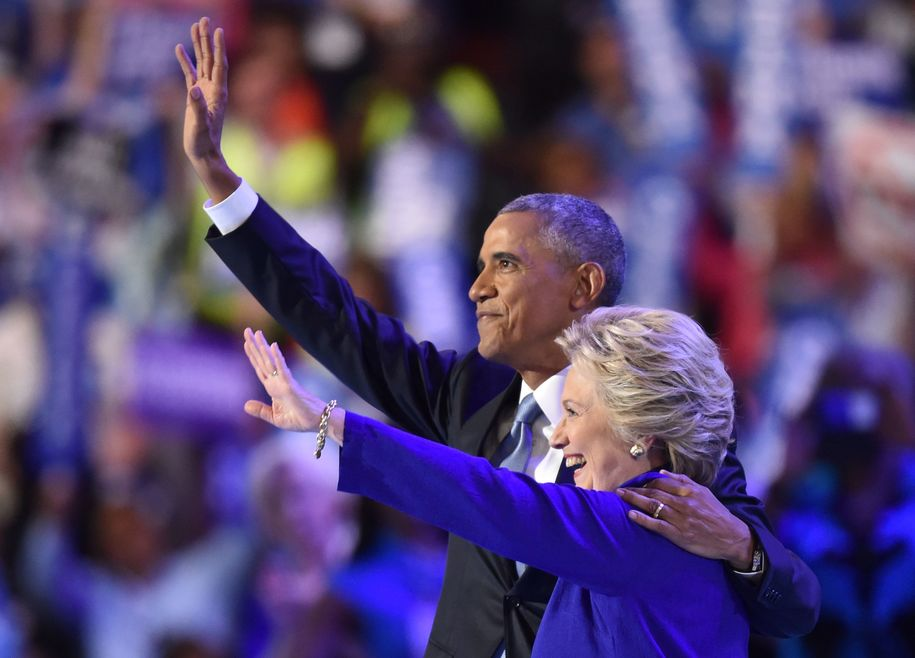 US President Barack Obama (L) waves with US Presidential nominee Hillary Clinton during the third night of the Democratic National Convention at the Wells Fargo Center in Philadelphia, Pennsylvania, July 27, 2016. / AFP / Nicholas Kamm        (Photo credit should read NICHOLAS KAMM/AFP/Getty Images)
