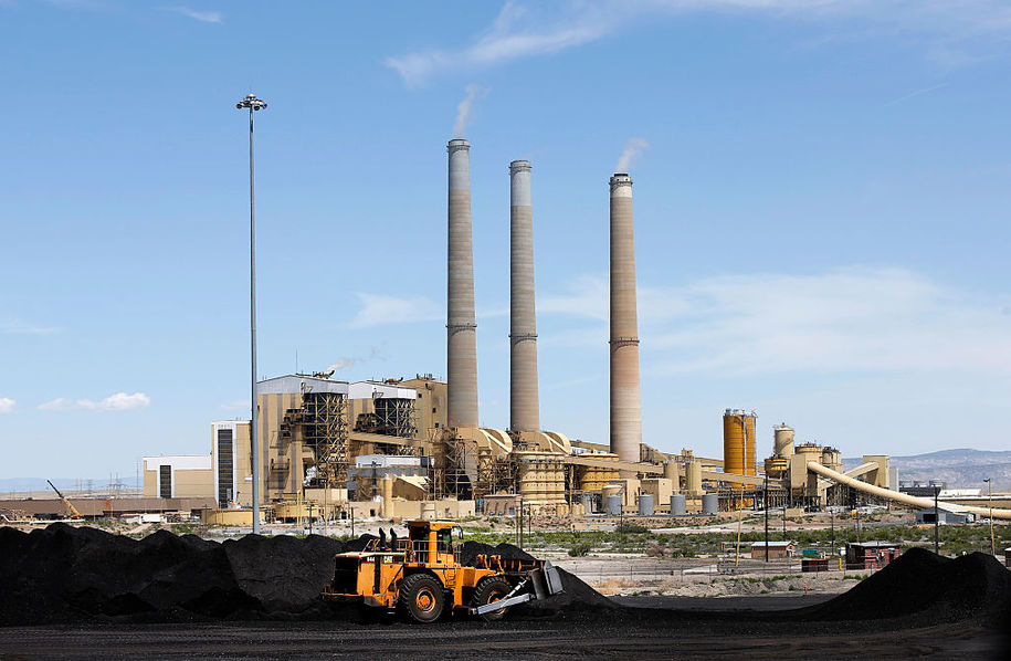 CASTLE DALE, UT - JUNE 3: A loader moves coal piles that sit outside the Hunter Power plant operated by PacifiCorp that are waiting to be burned to produce electricity on June 3, 2016 outside Castle Dale, Utah. The EPA announced new restrictions on the Huntington and Hunter coal fired power plants in Utah to help reduce pollution and haze at several National Parks in the area. (Photo by George Frey/Getty Images