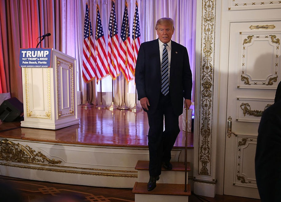 PALM BEACH, FL - MARCH 11:  Republican presidential candidate Donald Trump walks off stage after receiving the endorsement of former presidential candidate Ben Carson during a press conference at the Mar-A-Lago Club on March 11, 2016 in Palm Beach, Florida. Presidential candidates continue to campaign before Florida's March 15th primary day.  (Photo by Joe Raedle/Getty Images)