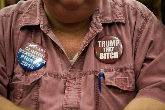 MANHEIM, PA - OCTOBER 1: A supporter of Republican presidential nominee Donald Trump wears anti-Hillary Clinton buttons at a campaign event on October 1, 2016 at the Spooky Nook Sports Complex in Manheim, Pennsylvania. Recent polls show Trump's rival Hillary Clinton with a narrow lead in the state. (Photo by Jessica Kourkounis/Getty Images)