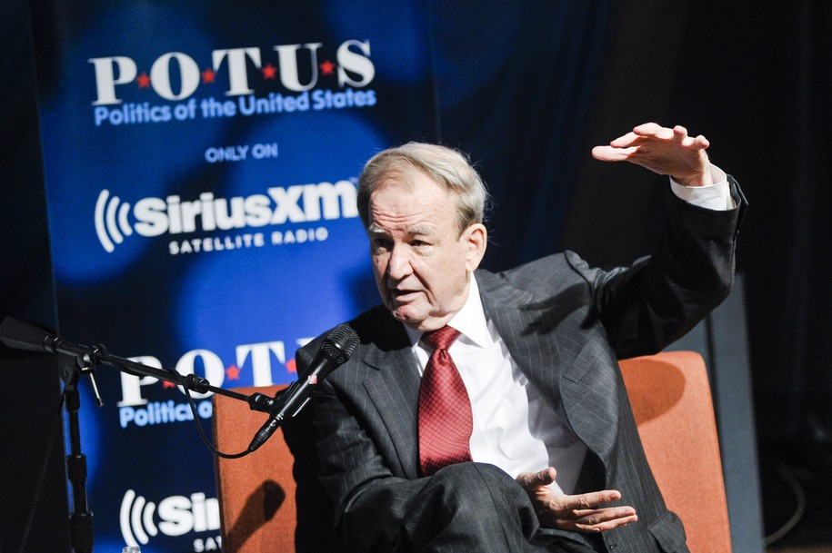 """WASHINGTON, DC - JULY 16: Pat Buchanan speaks while being interviewed by SiriusXM's Tim Farley about his latest book, """"The Greatest Comeback"""" at SiriusXM Studio on July 16, 2014 in Washington, DC. (Photo by Kris Connor/Getty Images for SiriusXM)"""