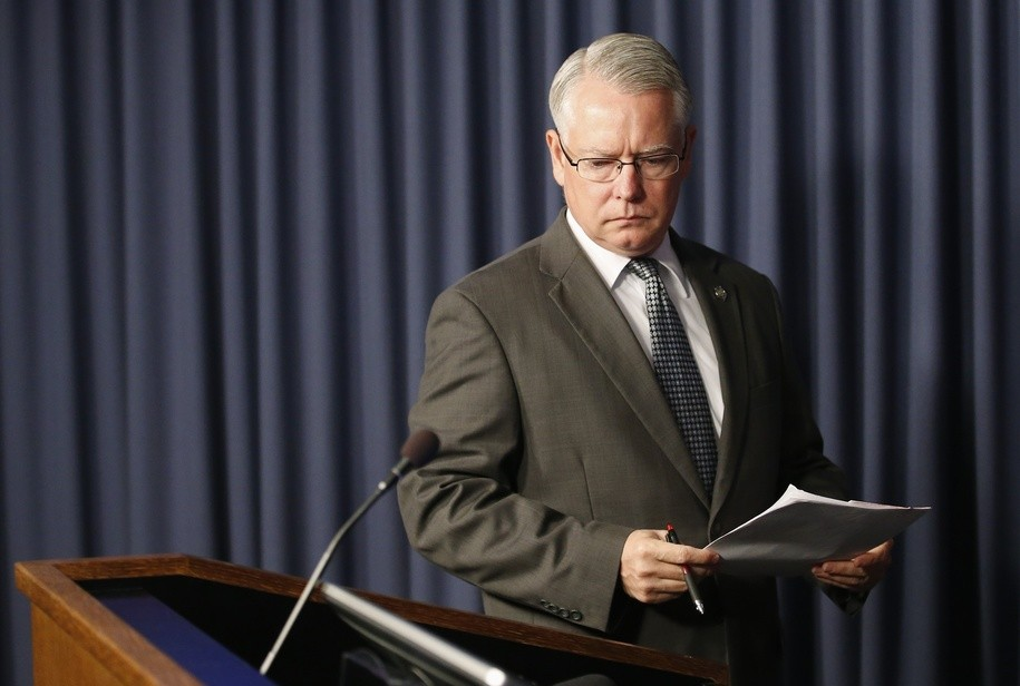 Maricopa County Attorney Bill Montgomery walks to the podium prior to announcing a Mesa police officer will not face criminal charges in the fatal shooting of Ivan Krstic during a confrontation last December during a news conference Thursday, May 19, 2016, in Phoenix. (AP Photo/Ross D. Franklin)
