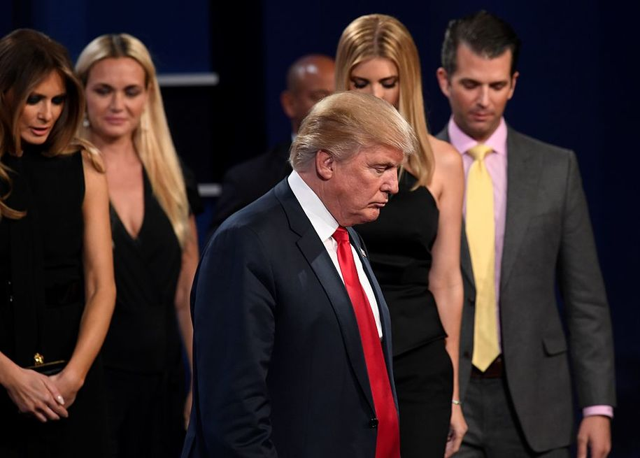 TOPSHOT - Republican presidential nominee Donald Trump (C) walks off the stage surrounded his wife Melania Trump (L), his son Donald Jr (R) and other memebers of his family after the final presidential debate at the Thomas & Mack Center on the campus of the University of Las Vegas in Las Vegas, Nevada on October 19, 2016. / AFP / Robyn Beck        (Photo credit should read ROBYN BECK/AFP/Getty Images)