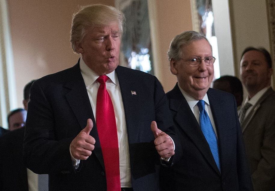 US President-elect Donald Trump gives the thumbs up after a meeting with Senate Majority Leader Mitch McConnell (R) at the Capitol in Washington, DC, on November 10, 2016. / AFP / NICHOLAS KAMM (Photo credit should read NICHOLAS KAMM/AFP/Getty Images)