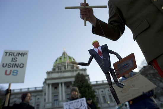 HARRISBURG, PA - DECEMBER 19:   Scott Greges, 35, dressed as Joseph Stalin, holds a marionette puppet of Donald Trump, joining protestors demonstrating outside the Pennsylvania Capitol Building before electors arrive to cast their votes from the election at December 19, 2016 in Harrisburg, Pennsylvania.  Electors from all 50 states cast votes today in their respective state capitols.  Donald J. Trump won Pennsylvania by less than 1%, the first Republican to carry the state since George H. W. Bush 1992.  (Photo by Mark Makela/Getty Images)