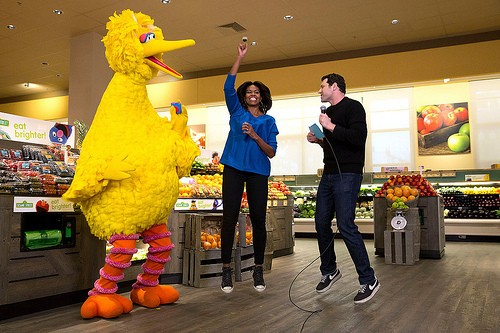 """First Lady Michelle Obama participates in a """"Let's Move!"""" Funny or Die game show taping with Billy Eichner of Billy on the Street and Big Bird at Safeway in Washington, D.C., Jan. 12, 2015. (Official White House Photo by Amanda Lucidon)"""