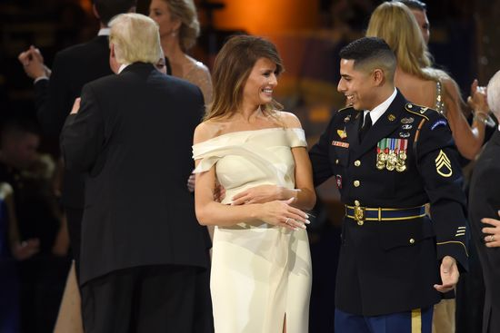 US First Lady Melania Trump (C) dances with a member of the Marine Corps (R) during the Salute to Our Armed Services Inaugural Ball at the National Building Museum in Washington, DC, January 20, 2017. / AFP / SAUL LOEB        (Photo credit should read SAUL LOEB/AFP/Getty Images)