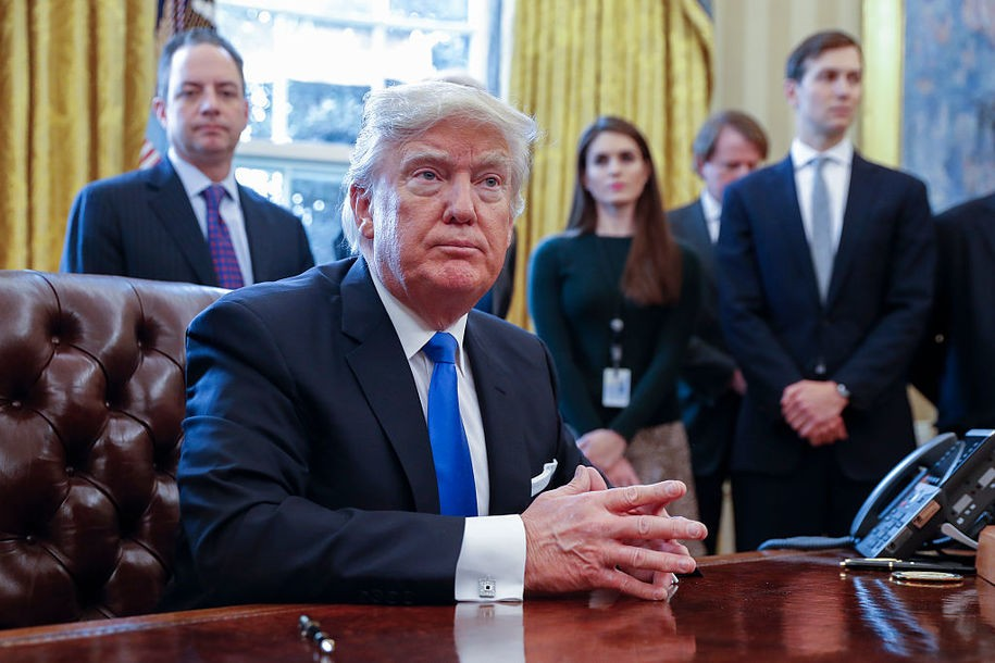 WASHINGTON, DC - JANUARY 24: President Donald Trump looks on after signing one of five executive orders related to the oil pipeline industry in the Oval Office of the White House January 24, 2017 in Washington, DC. Also pictured are White House Chief of Staff Reince Priebus (L), White House Communications Director Hope Hicks (2nd R) and Senior Advisor Jared Kushner (R). (Photo by Shawn Thew-Pool/Getty Images)