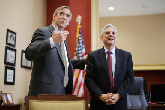 WASHINGTON, DC - MAY 19:  U.S. Supreme Court nominee and chief judge of the United States Court of Appeals for the District of Columbia Circuit Merrick Garland (R) and Sen. Jeff Merkley (D-OR) look at paintings one the walls of his office before a meeting in the Hart Senate Office Building on Capitol Hill May 19, 2016 in Washington, DC. Senate Republicans have so far refused to schedule a confirmation hearing for Garland, who was nominated by President Barack Obama to fill a vacancy on the court left when Associate Justice Antonin Scalia died earlier this year.  (Photo by Chip Somodevilla/Getty Images)