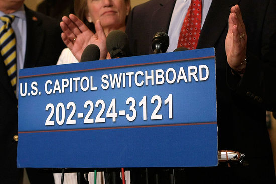 WASHINGTON - AUGUST 18:  The phone number of the U.S. Capitol switchboard is displayed during a news conference to call on Speaker of the House Rep. Nancy Pelosi (D-CA) to open up a debate on offshore drilling on Capitol Hill August 18, 2008 in Washington, DC. House Republicans have urged people to call Democratic House Representatives in their districts to return to the Congress from their recess for the debate.  (Photo by Alex Wong/Getty Images)