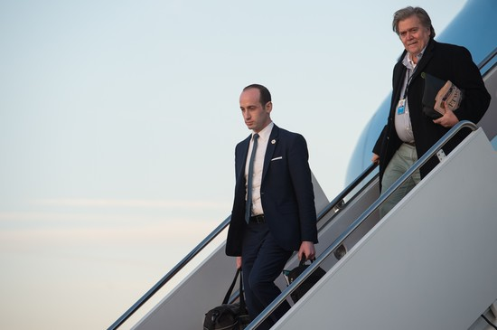 Senior White House advisers Stephen Miller (L) and Steve Bannon step off Air Force One at Andrews Air Force Base in Maryland, on March 5, 2017. / AFP PHOTO / NICHOLAS KAMM        (Photo credit should read NICHOLAS KAMM/AFP/Getty Images)