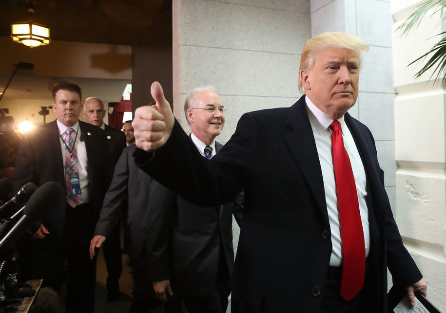 WASHINGTON, DC - MARCH 21: U.S. President Donald Trump gives a thumbs up as he and HHS Secretary Tom Price walk to a House Republican closed party conference on Capitol Hill, on March 21, 2017 in Washington, DC. President Trump is urging House Republicans to support his American Health Care Act..  (Photo by Mark Wilson/Getty Images)